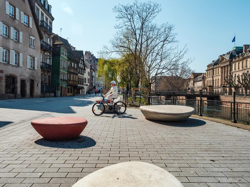Girl on a bicycle in the empty city of Strasbourg royalty free stock image