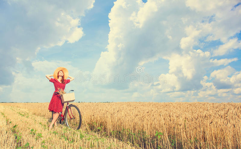 Girl with bicycle on field. stock images