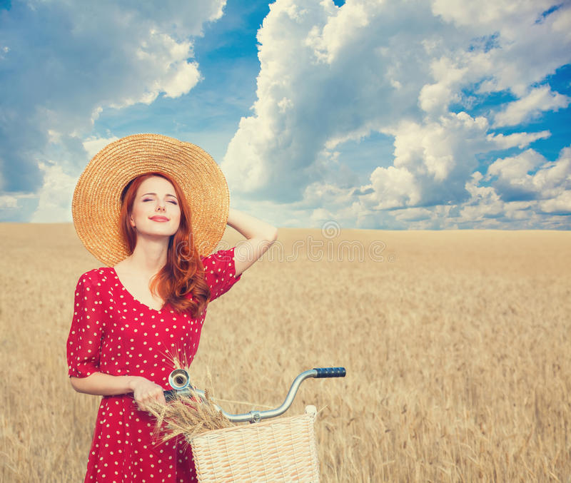 Girl with bicycle on field. royalty free stock photography