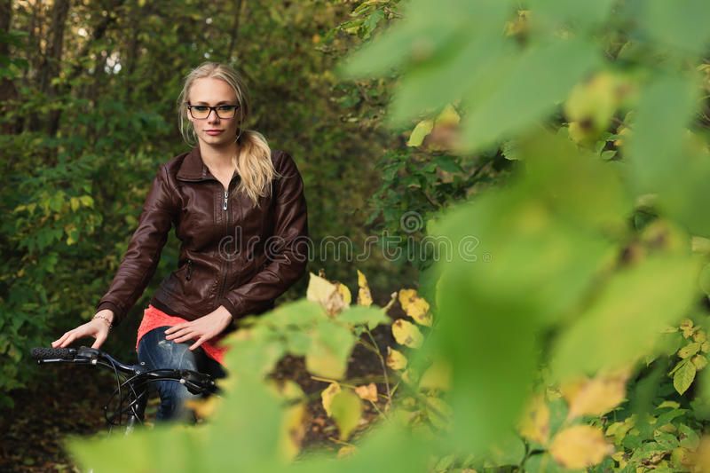 Download Girl On Bicycle In Forest Royalty Free Stock Images - Image: 27011169