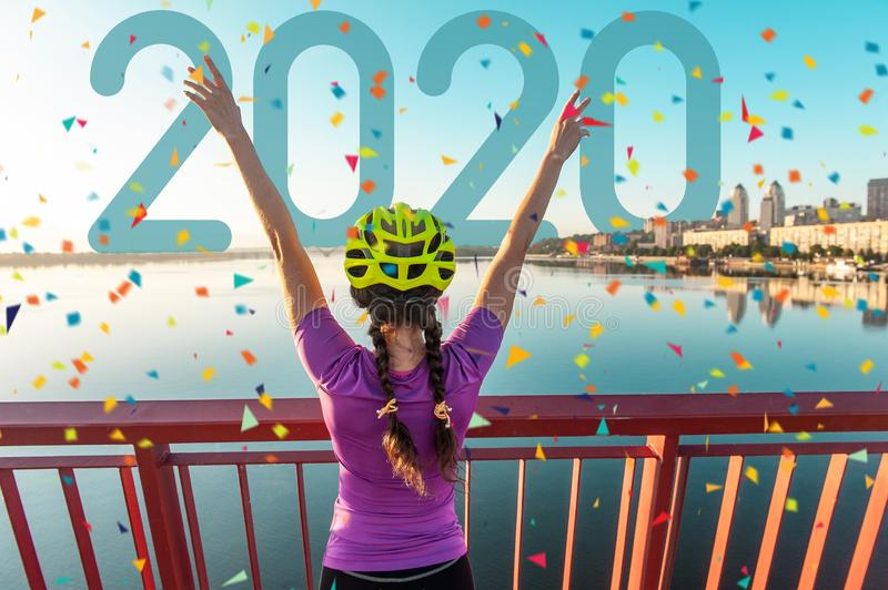 Girl cyclist in a helmet at the finish stock photography