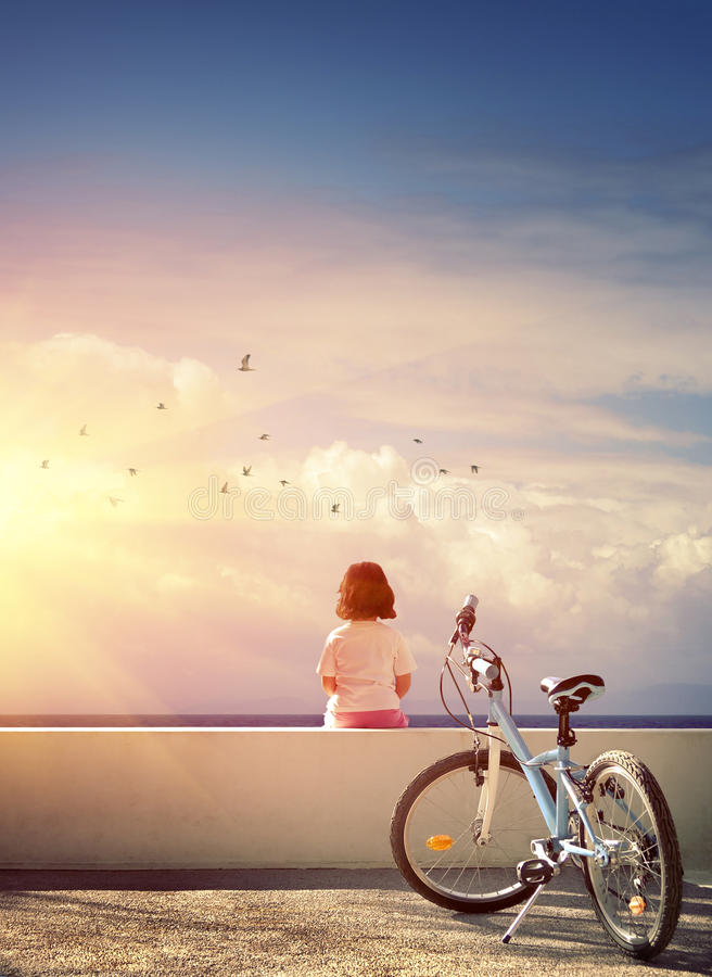 Girl and Bicycle stock images