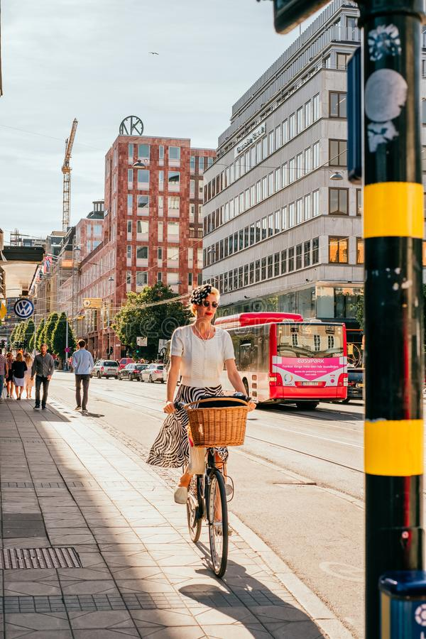 Girl on the bicycle in Stockholm stock images