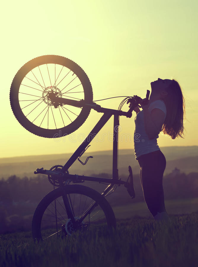 Girl on a bicycle royalty free stock image