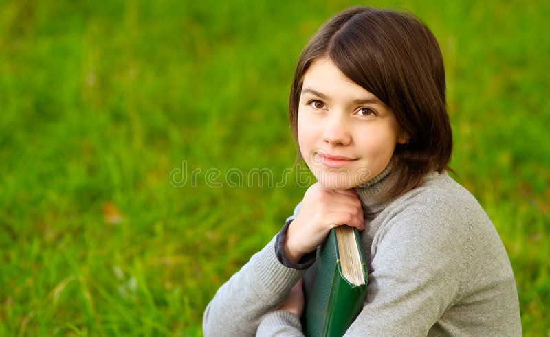 Download Girl with big book stock photo. Image of plot, field, grass - 7389070