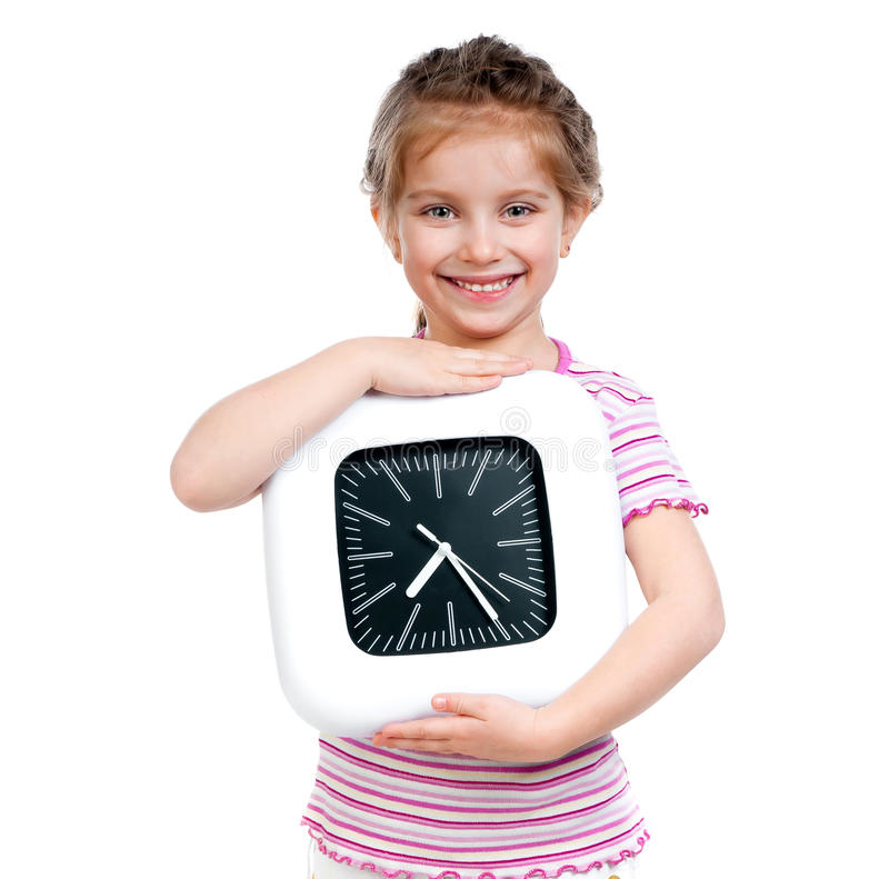 Girl with big clock. Little pretty girl with big clock royalty free stock photography