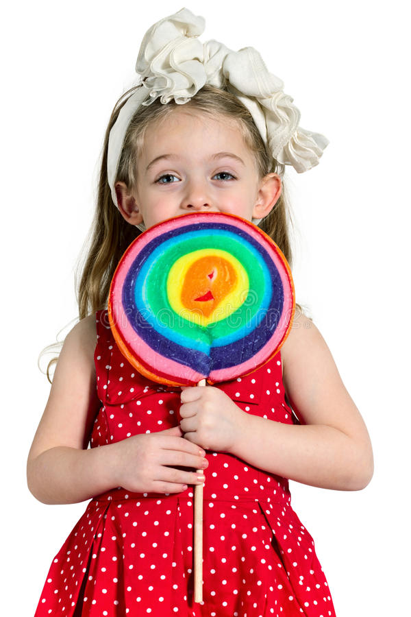 Girl with a big colorful lollipop stock photos