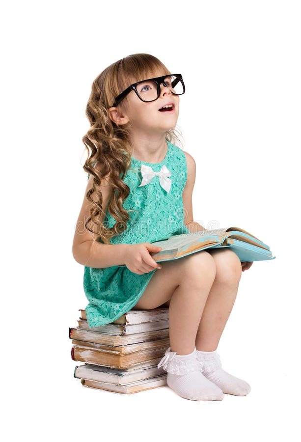 Girl in big glass and books royalty free stock image
