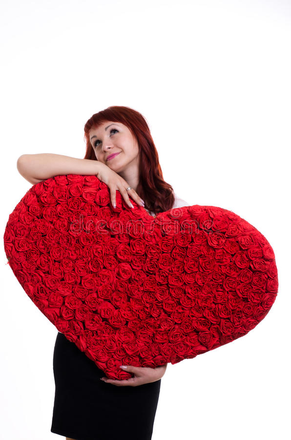 Girl with a big heart in the hands stock images