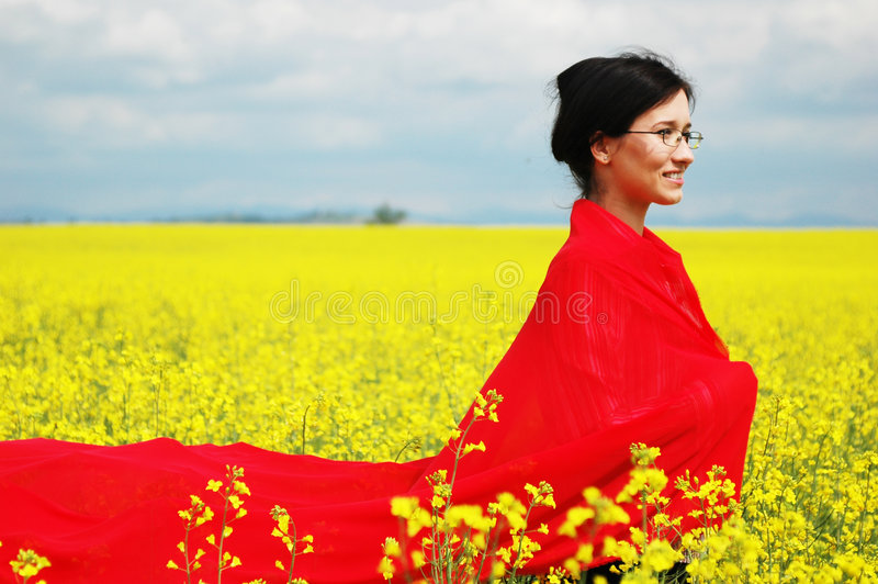 Girl with big red scarf. Young girl, wearing a very long red scarf, in the middle of nature. great color game
