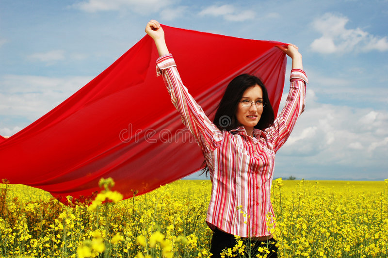 Girl with big red scarf 2 royalty free stock images