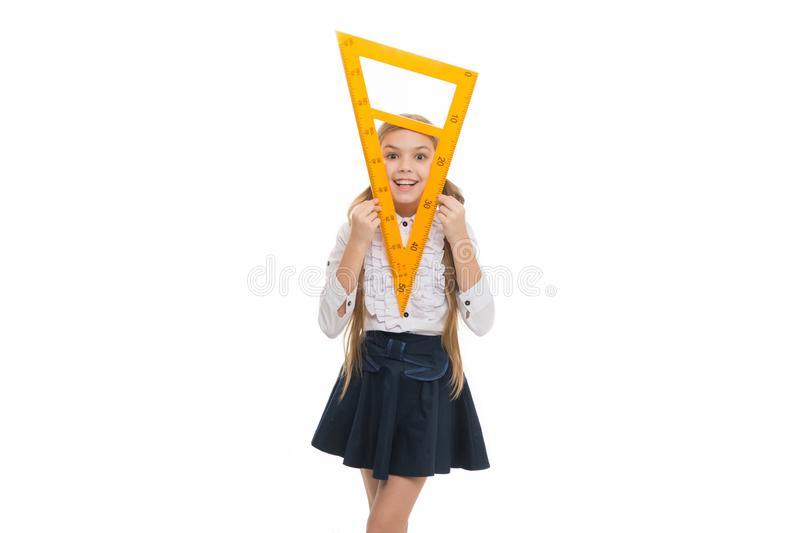 Girl with big ruler. Favorite school subject. Education and school concept. School student learning geometry. Kid school stock image