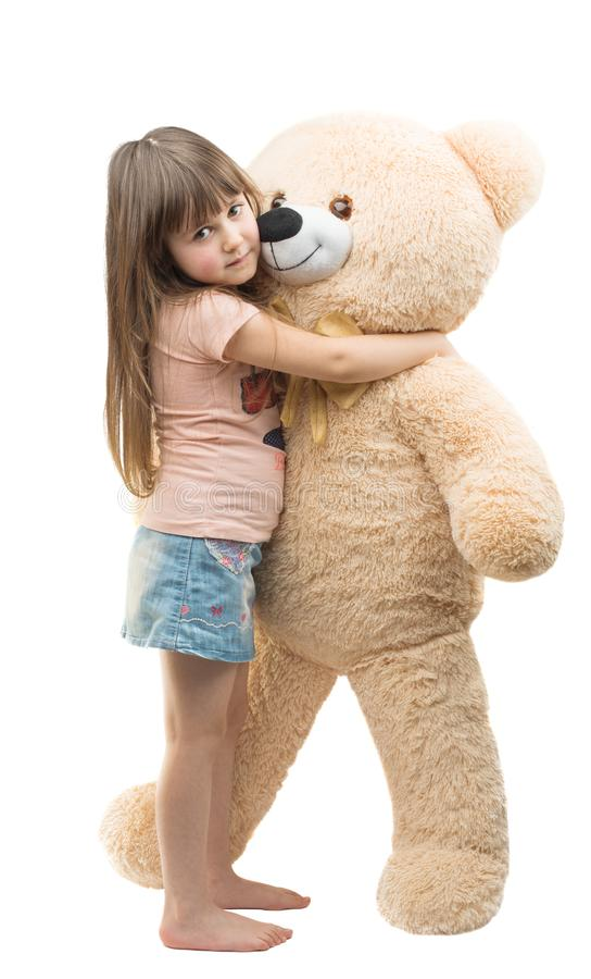 Girl with big soft bear. On a white background stock image