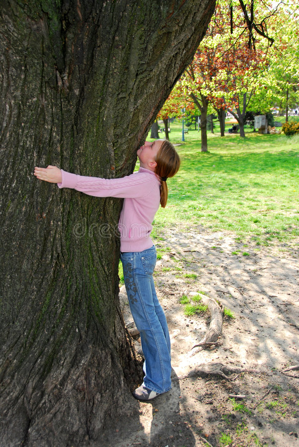 Girl and big tree. Young girl standing near ancient big tree. Protect environment concept stock photos