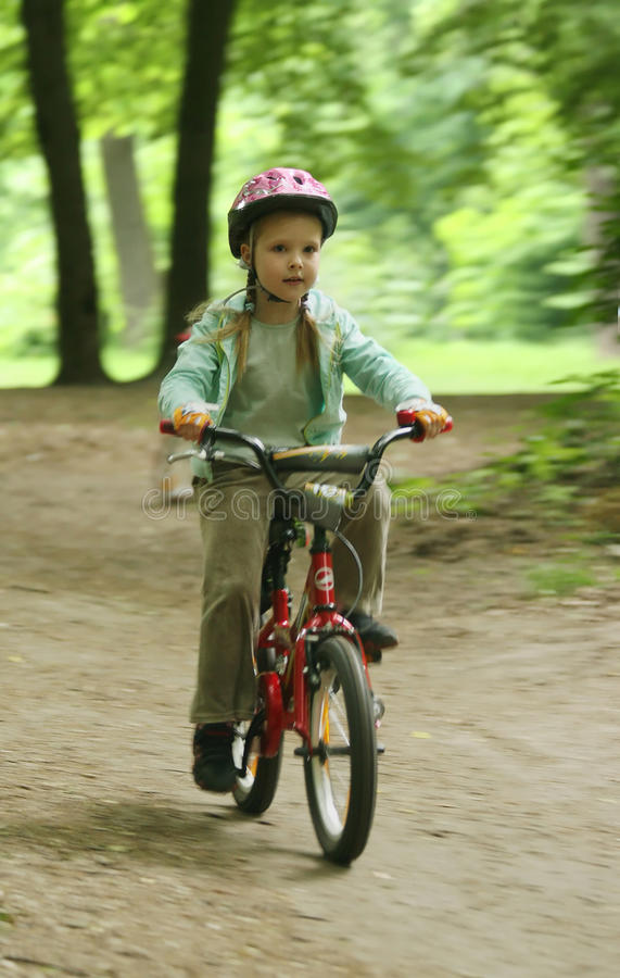 Girl on the bike. UKRAINE, KIEV - MAY 30: Marina Ivchenko with blurred background, at the child amateur bicycle competition We are the champions, on May 30 royalty free stock images