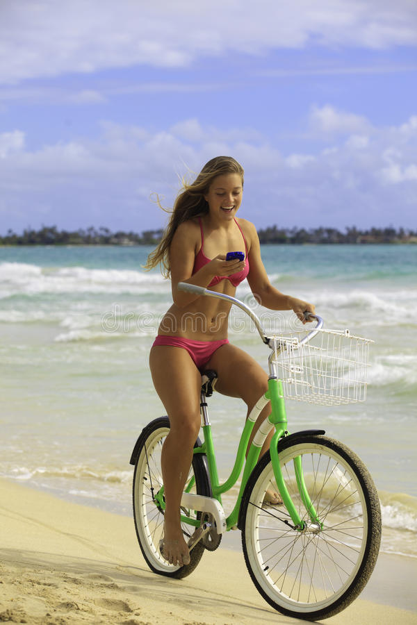 Download Girl On Bike At Beach Texting Stock Photo - Image: 25951100