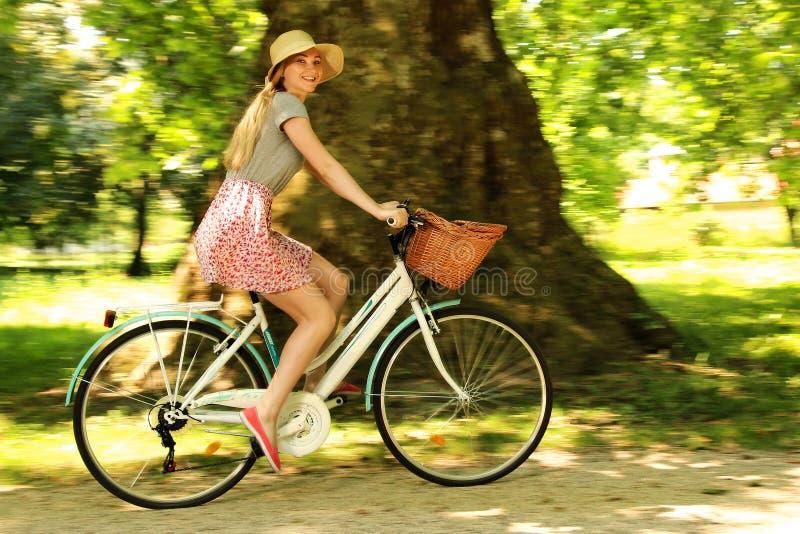 Girl on bike stock images
