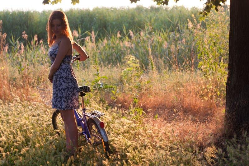 Girl and bike royalty free stock photo