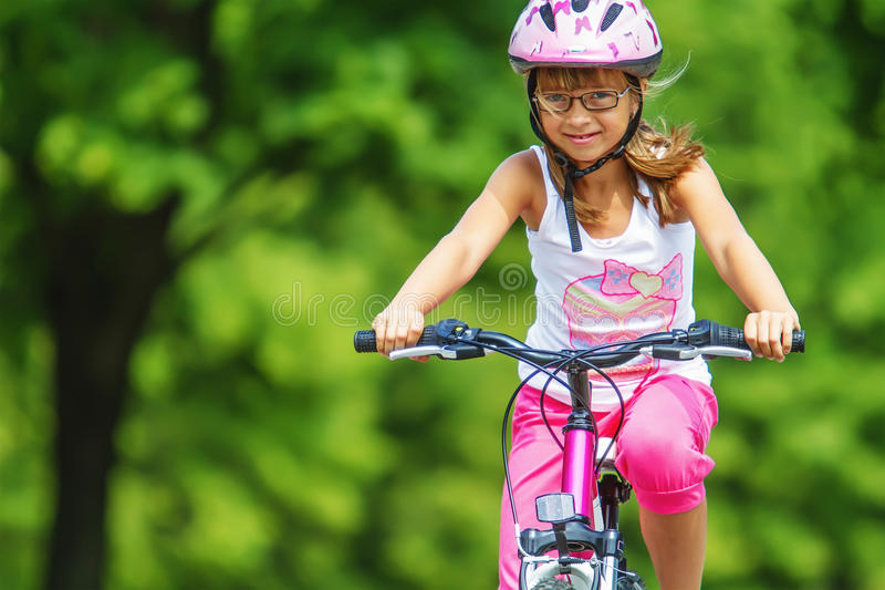Little girl on bike stock photos