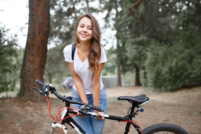 The Girl On The Bike Ride In The Woods On A Mountain Bike