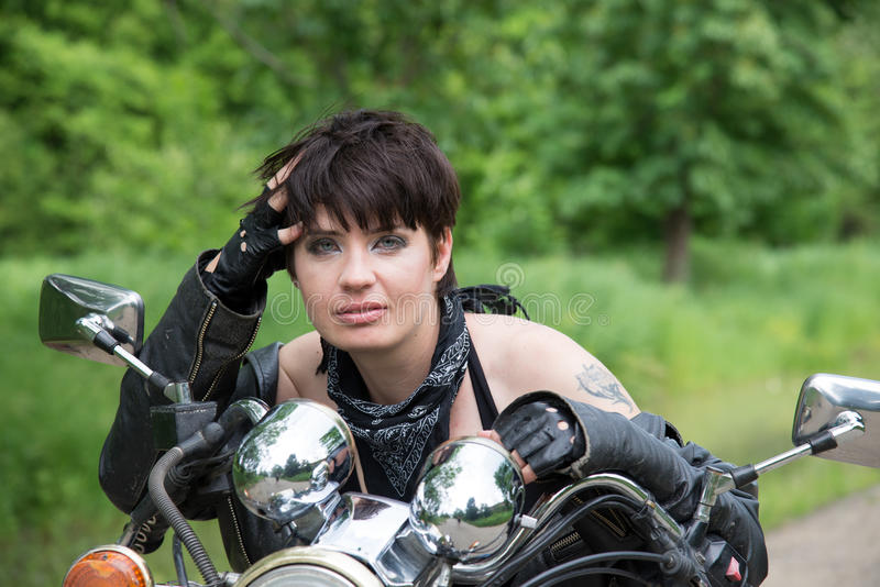 Girl on a bike stock image