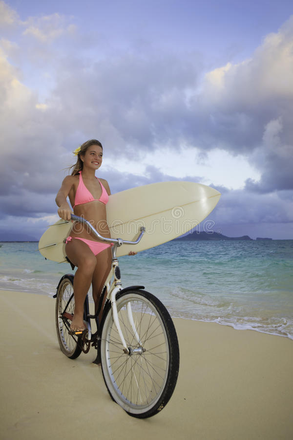 Download Girl With Bike And Surfboard Stock Photo - Image: 17782862