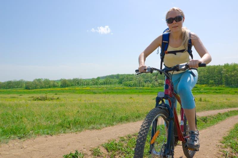 Girl biking royalty free stock photos