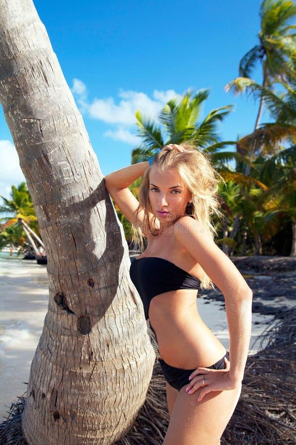Girl in bikini on caribbean beach stock photos