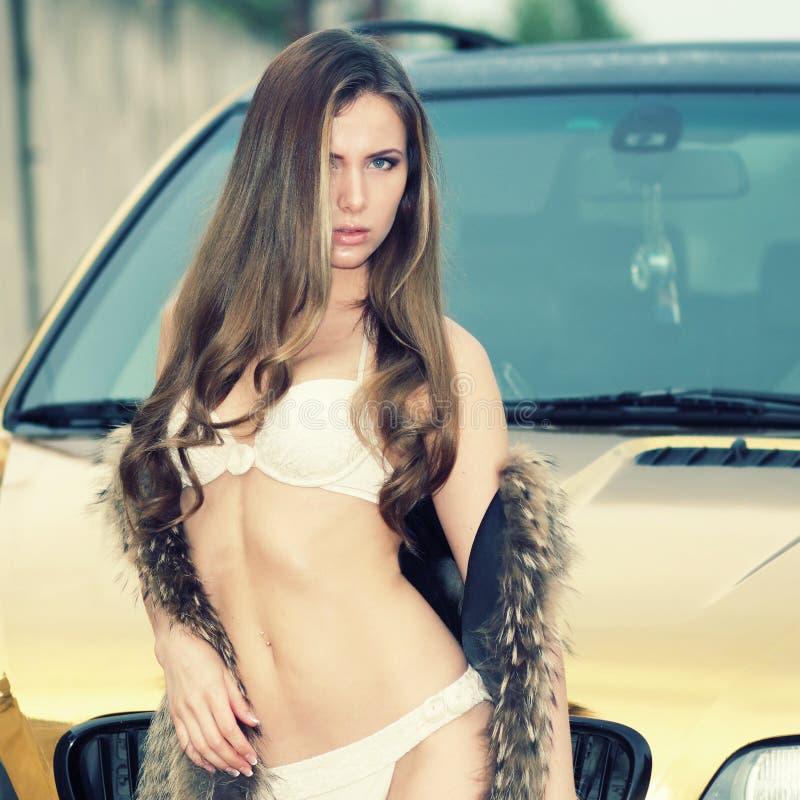 Girl in bikini near the car royalty free stock photography