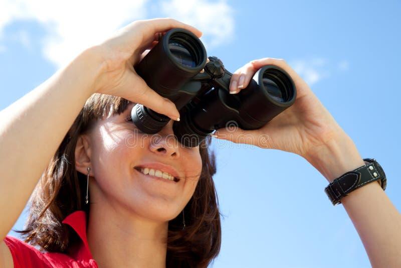 Girl with binoculars stock image