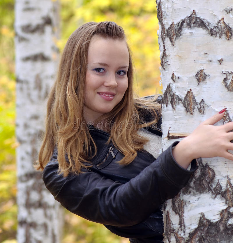 Girl at a birch forest royalty free stock photography