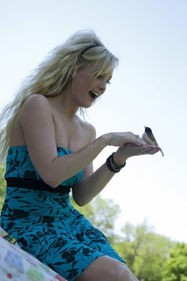 Girl and bird royalty free stock photos