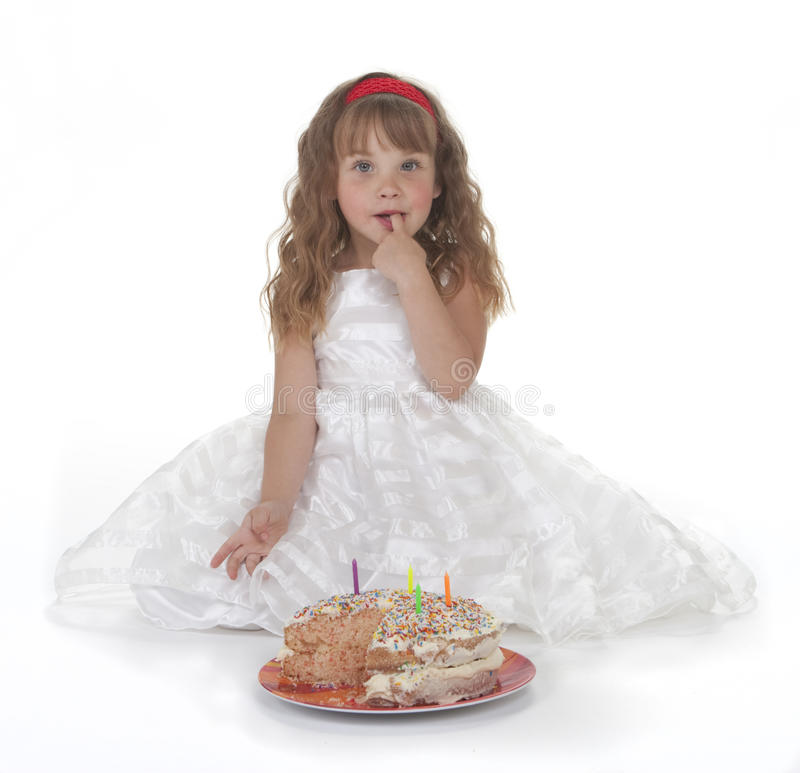 Girl and Birthday Cake. Four year old girl in white party dress with birthday cake. White background stock photography