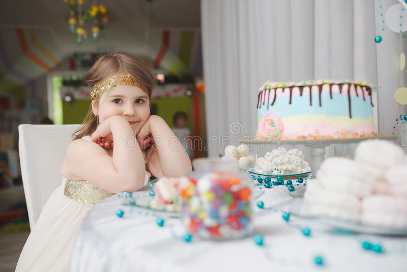 Girl with birthday cake at home royalty free stock photo