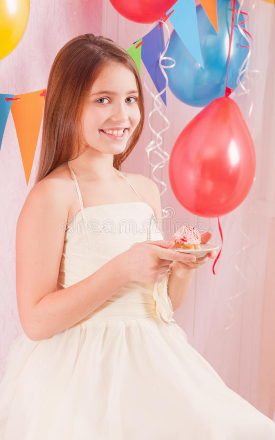 Girl with birthday cake. Indoor royalty free stock images