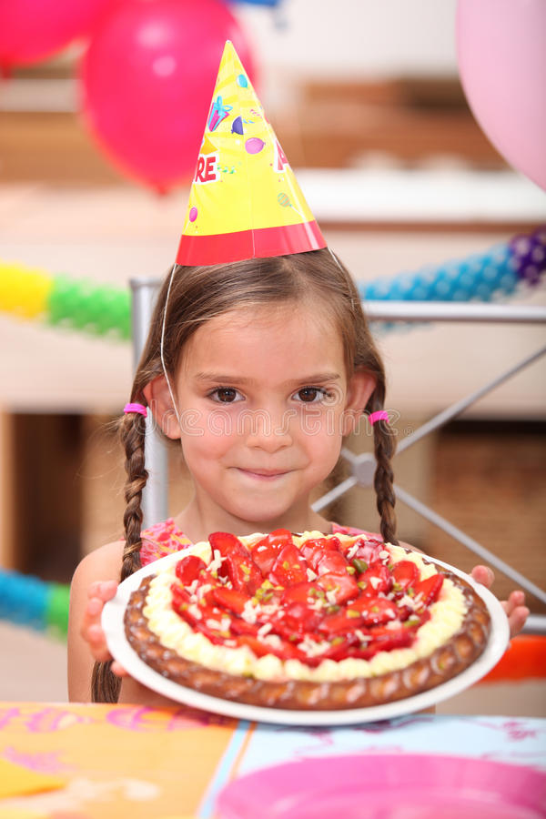 Girl with birthday cake. Little girl with birthday cake royalty free stock images