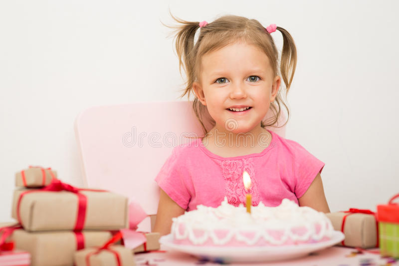 Girl with a birthday cake royalty free stock photo