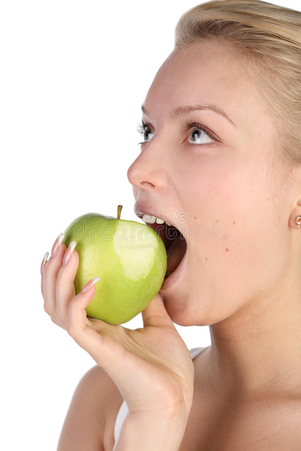 Girl bites off from apple royalty free stock image
