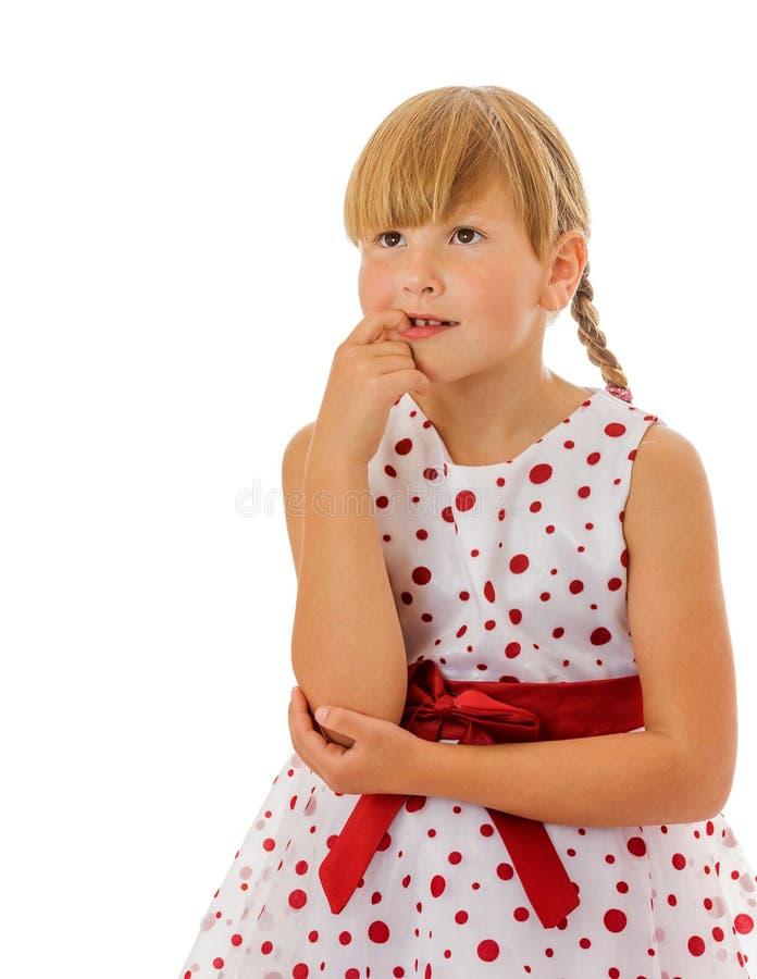 Girl biting fingers stock photo