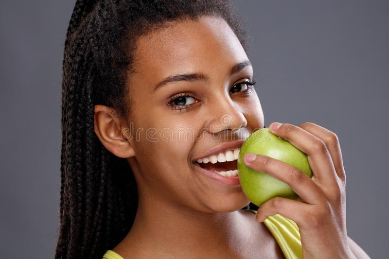 Girl when biting green apple stock images