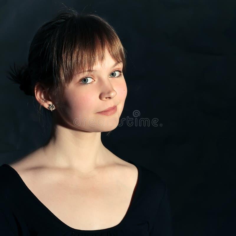 Girl on black background stock photography