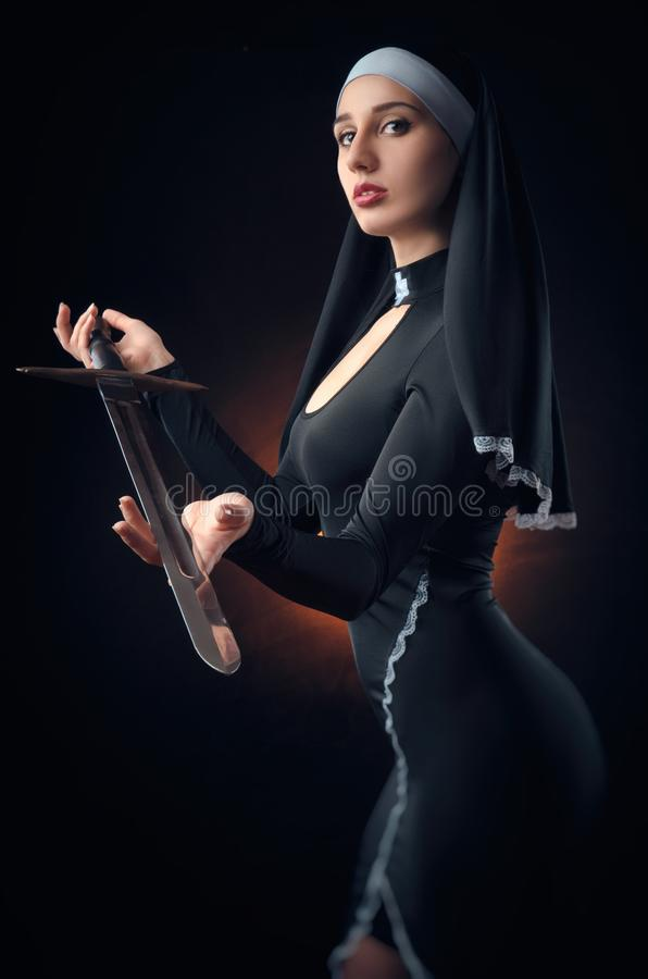 A nun with a weapon in the name of faith stock images
