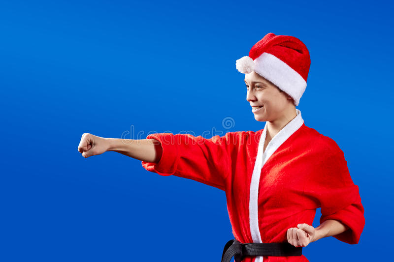 Girl with a black belt beats punch. Girl with a black belt beats blow royalty free stock images