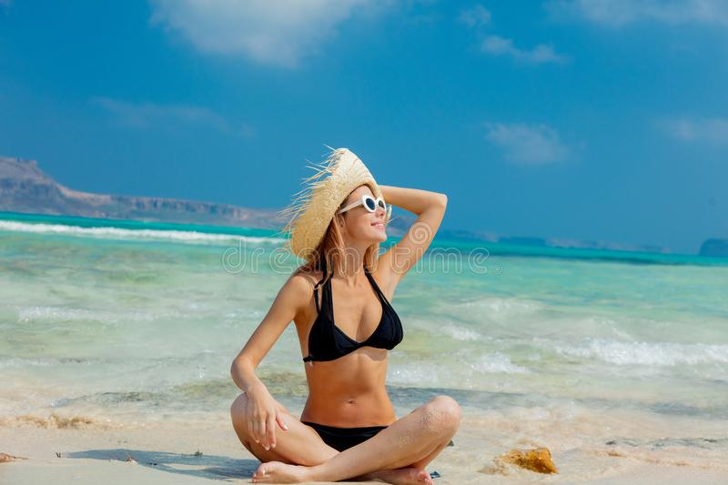Girl in black bikini and with hat on Balos beach. Young redhead girl in black bikini and with hat on Balos beach, west Crete, Greece. Summertime season vacation stock photos