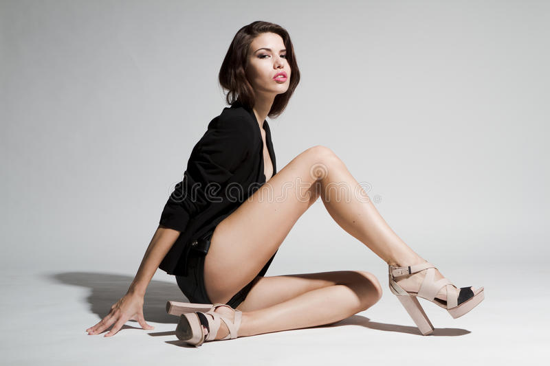 Girl In Black Blazer And Leather Shorts Royalty Free Stock Photos