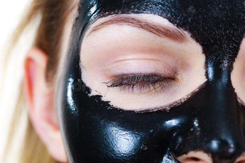 Girl black carbo peel off mask on face stock photography