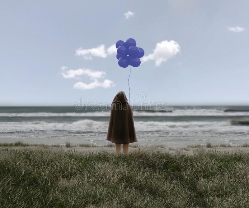 Girl in a black cloak holding balloons. On the beach royalty free stock images
