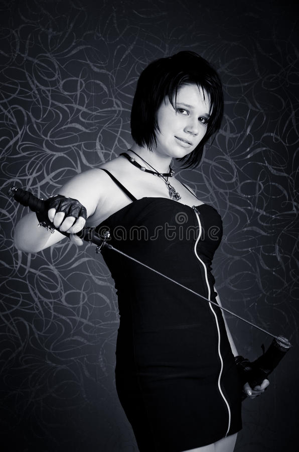 Girl in a black dress with a katana