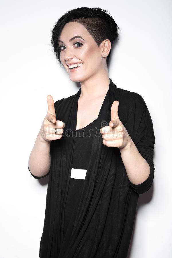 Girl in a black dress with shaved head in art gothic style. Picture taken in the studio on a white background stock image