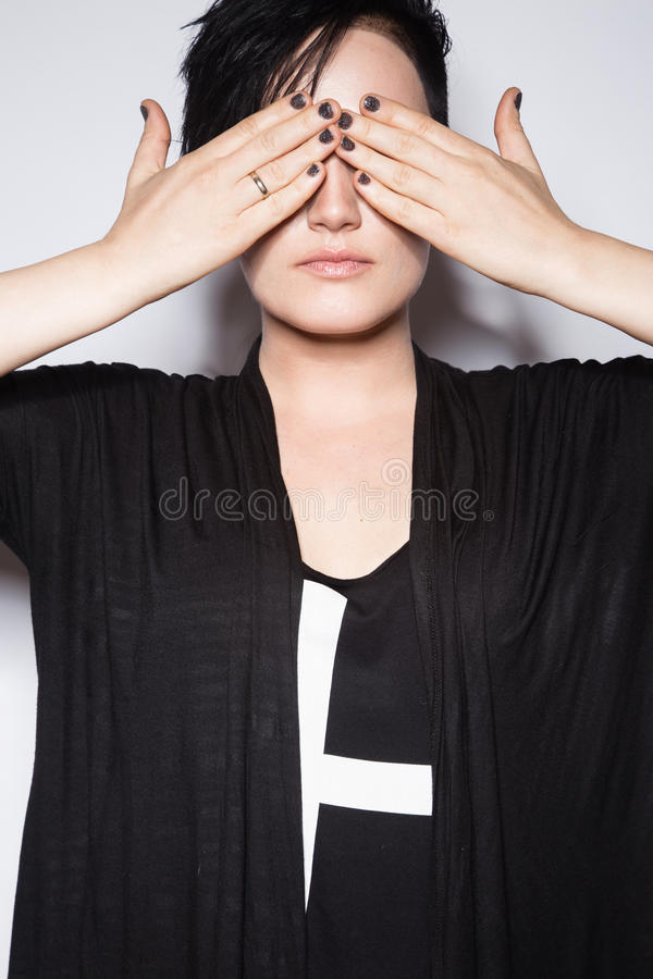 Girl in a black dress with shaved head, art gothic style. Girl in a black dress with shaved head in art gothic style. Picture taken in the studio on a white royalty free stock image
